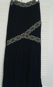 Dresses & Skirts - Black maxi skirt w/ front detail & swing bottom